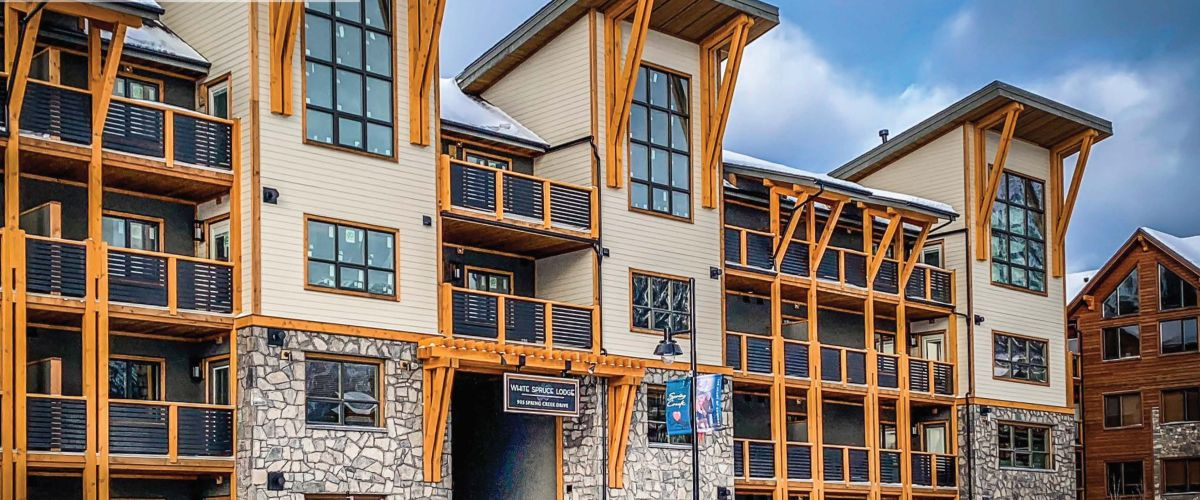 The outside of the White Spruce Lodge Rentals in the winter.