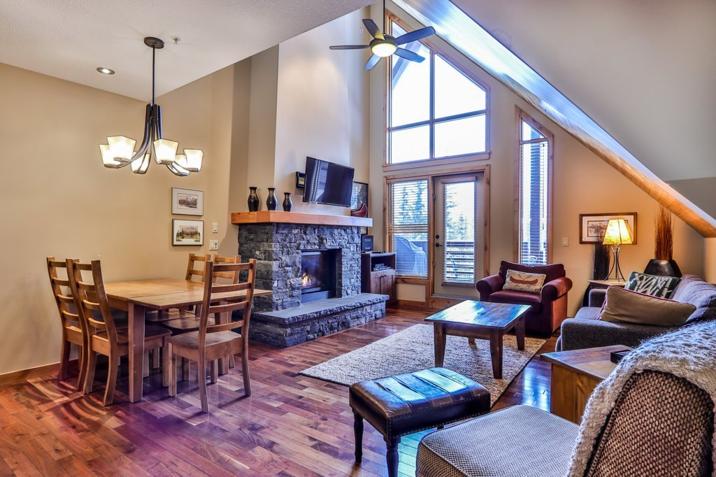 living room and dining table in #400 Rundle Cliffs Lodge