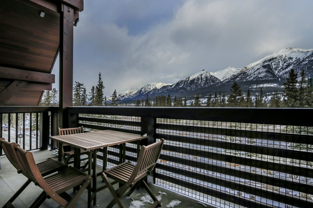 balcony with patio furniture and view of the mountains in #401 Rundle Cliffs Lodge