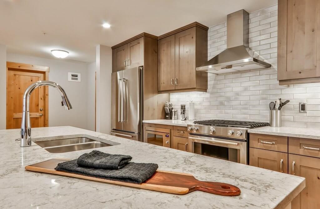 full kitchen with appliances in #301 White Spruce Lodge