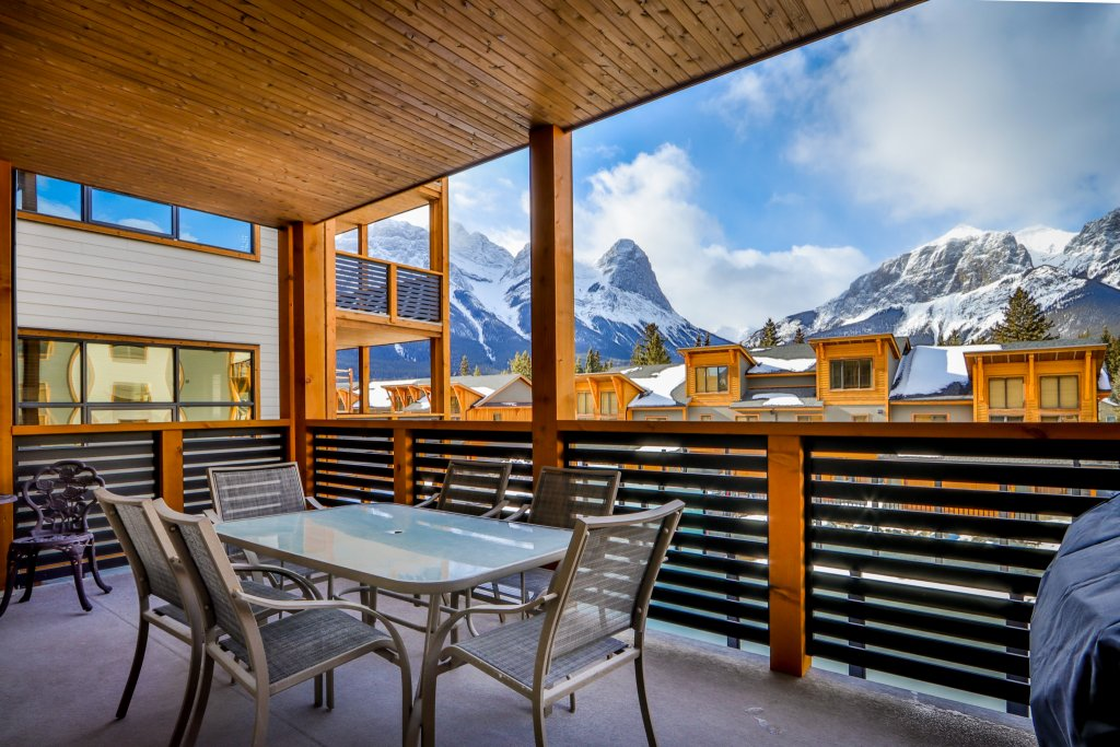 balcony with patio furniture and view of the mountains in #206 White Spruce Lodge