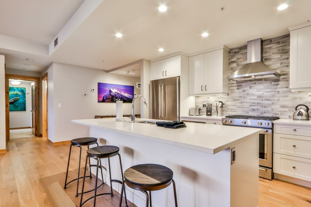 kitchen with island and seat bar in #206 White Spruce Lodge