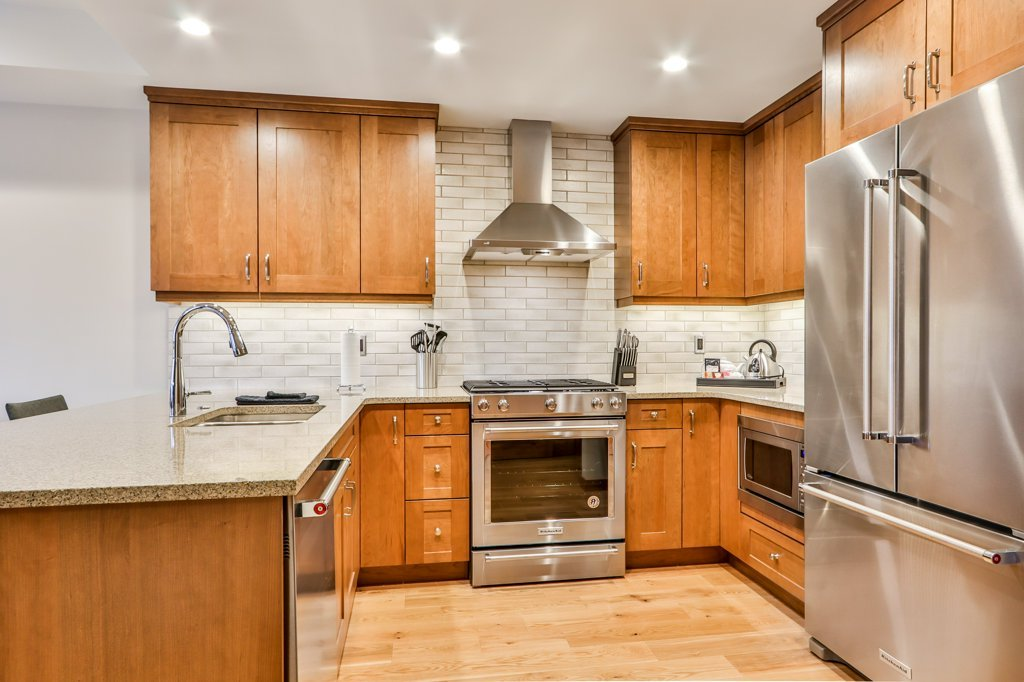 kitchen with stove, fridge, microwave, dishwasher, and sink in #311 White Spruce Lodge