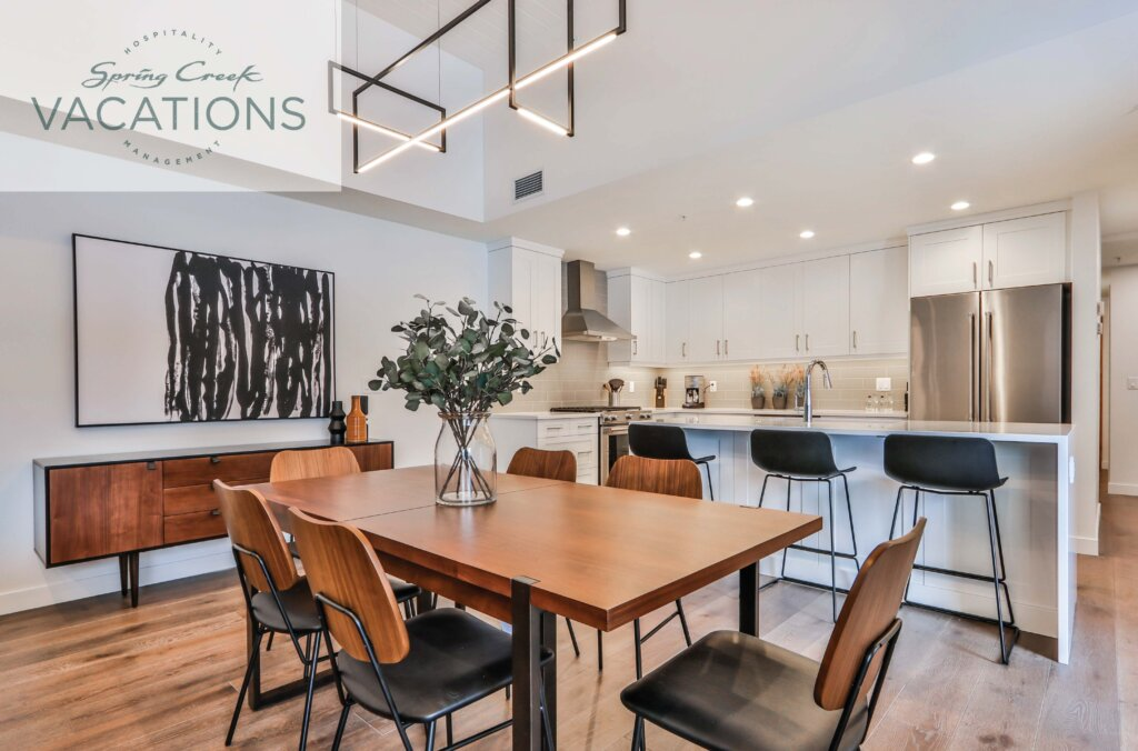 Bright open-concept kitchen and dining area in a Spring Creek Vacations rental suite