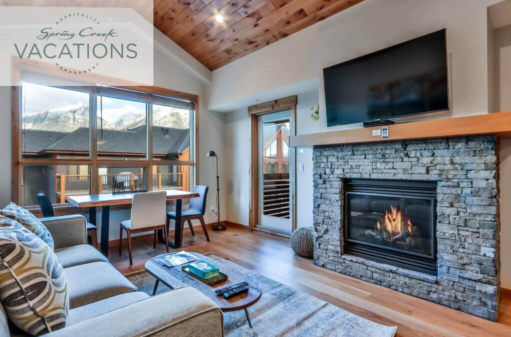 Living room with fireplace and view of Three Sisters at Spring Creek Vacations rental suite