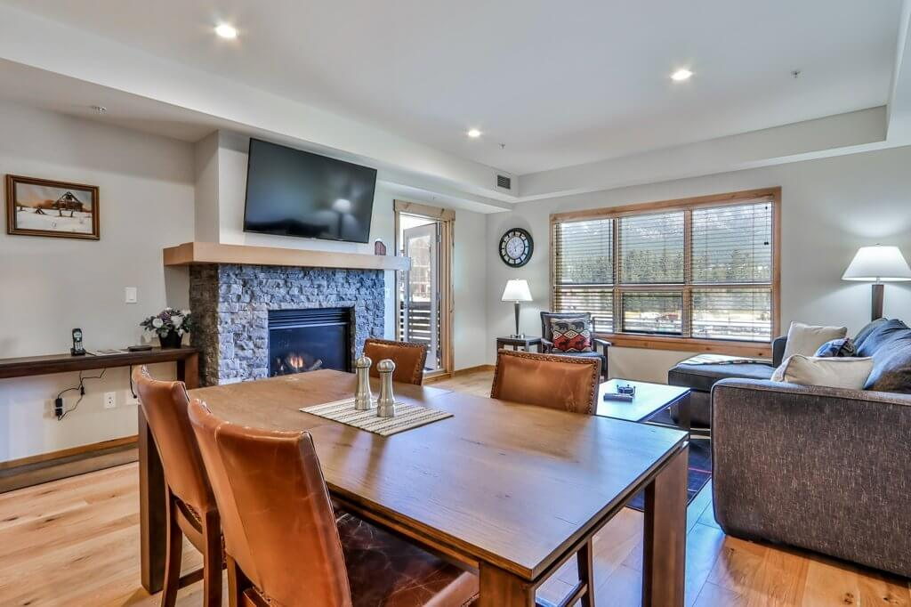 dining table and living room at #202 White Spruce Lodge