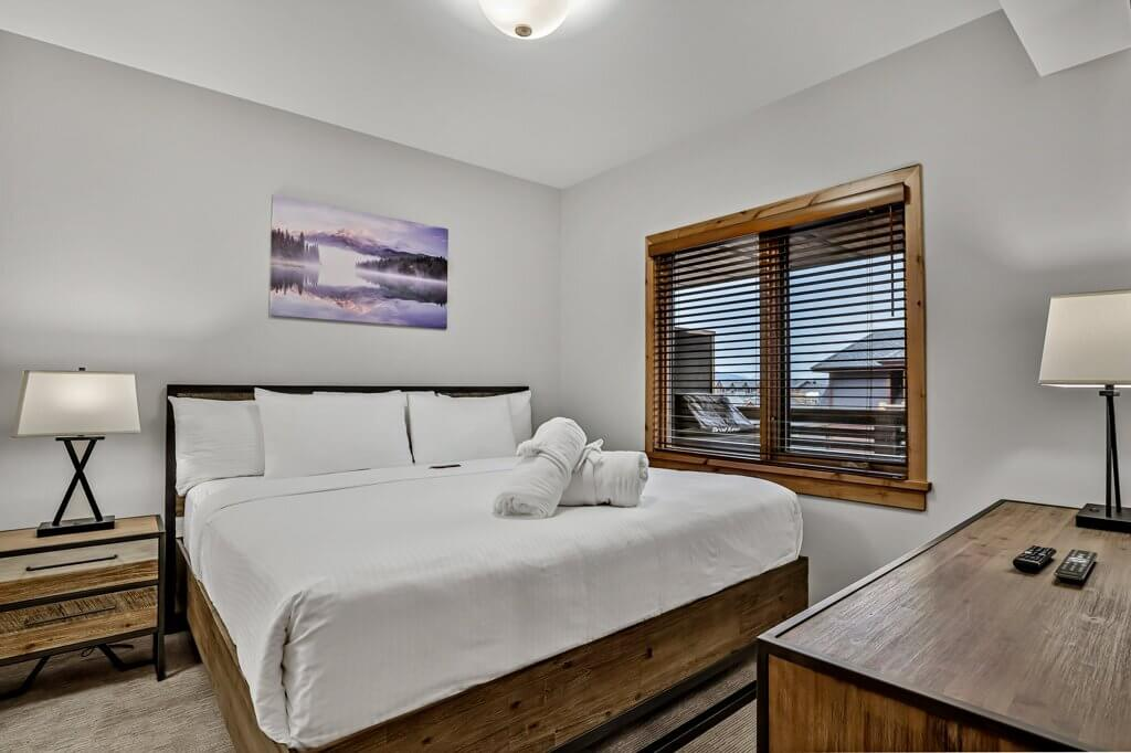 Brightly-lit bedroom view from a unit at Spring Creek Vacations in Canmore