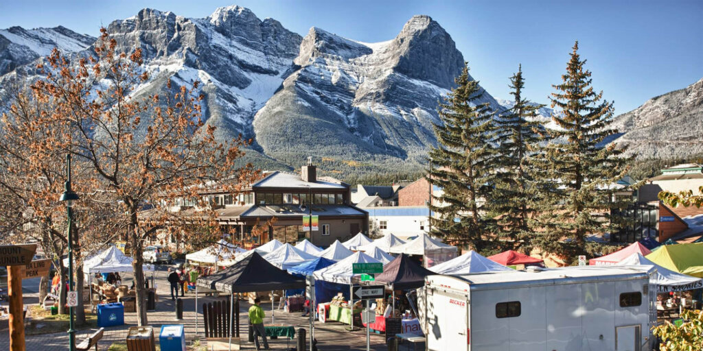 Downtown Canmore during an outdoor event, with tents set up on Main Street.