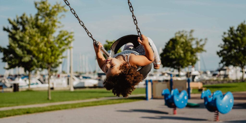 Girl in tire swing in a park